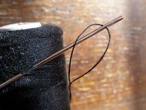 Thread spool and needle Royalty Free Stock Photos