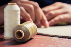 Thread spools. Closeup thread spools for quilting with hand sewing on background Stock Photo