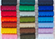 Colored thread spools close up background Royalty Free Stock Images