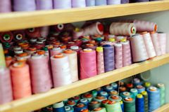 Thread spools in fabric industry Stock Photos