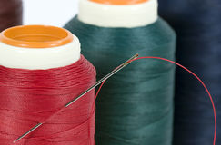 Thread Spools with Needle Royalty Free Stock Photos