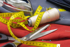 Thread Spools, Pin and Yellow Measuring Tape and Large Dressmaki Stock Photography
