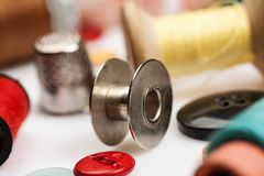 Thread spools, thimbles and other items for sewing close-up shot stock photography