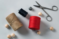 Thread, string, thimble and scissors Royalty Free Stock Photos