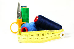 Thread with a tape measure and scissors. On the white background Stock Image