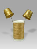 Thread and thimbles. Royalty Free Stock Image
