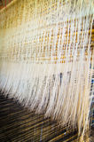 Thread on the traditional weaving machine Stock Photos