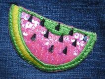 Thread water melon. Watermelon design on jeans texture Stock Photos
