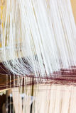 Thread from weaving machine, Abstract background - selective foc Stock Photos