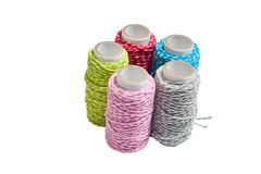 Thread on white isolated background. Red blue pink gray green threads on white isolated background Stock Photo
