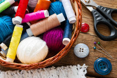 Thread and yarn in a basket next to the buttons Stock Photo