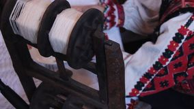Thread yarn on wooden spool stock footage