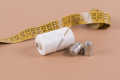Threadand measuring tape Stock Images