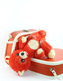 Threadbare old bear. Worm bear and small suitcases Royalty Free Stock Image