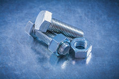 Threaded bolt details with screw-nuts on metallic background con Royalty Free Stock Photography