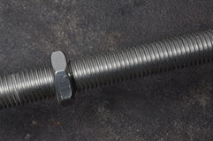 Threaded bolt with a nut Royalty Free Stock Image