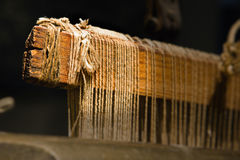 Threaded Loom. Closeup photograph of an old threaded loom Royalty Free Stock Images