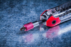 Threaded muunction screwdriver on metallic surface construction Stock Image
