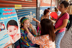 Threading in Chinatown Bangkok. Stock Image