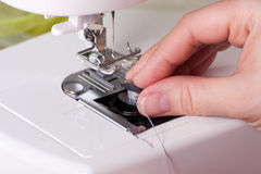 Threading a Sewing Machine Royalty Free Stock Photos