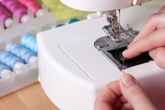 Threading a Needle in Sewing Machine Royalty Free Stock Photos