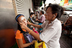 Threading (hair removal) in Chinatown Bangkok. stock images