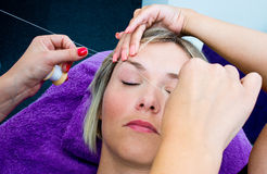 Threading hair removal procedure Royalty Free Stock Photos