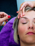 Threading hair removal procedure Royalty Free Stock Photo