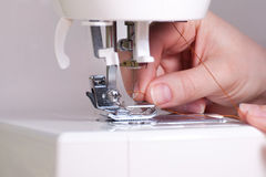 Threading a Needle in Sewing Mahine Royalty Free Stock Photography