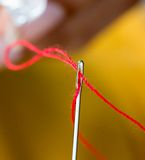 Threading Needle Means Tailoring Sew And Dressmaking Royalty Free Stock Image