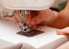 Threading a thread in a sewing machine Royalty Free Stock Photography