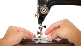 Threading a vintage sewing machine Royalty Free Stock Photography