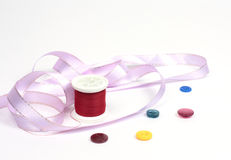 Threads with buttons and tape Royalty Free Stock Images