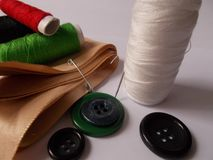Threads of cotton, buttons and ribbon royalty free stock image