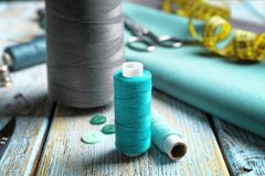 Threads and fabric for tailoring on table,. Closeup Royalty Free Stock Photo