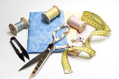 Threads and fabrics with a scissor Royalty Free Stock Images