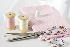 Threads and fabrics with scissors Royalty Free Stock Image