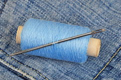Threads on jeans backround Stock Photos