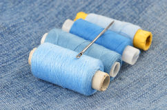 Threads on jeans backround Stock Image