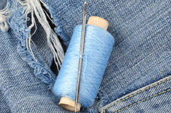 Threads on jeans, wear repair concept Stock Photography