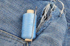 Threads on jeans, wear repair concept Royalty Free Stock Photos