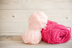 Threads for knitting with spokes on wooden table Stock Image