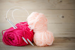 Threads for knitting with spokes on wooden table Stock Images
