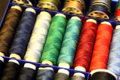 Threads. Multicolored sewing threads, close-up Stock Photos