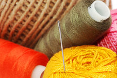 Threads and needle Stock Images