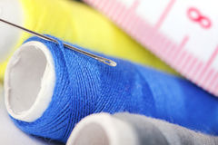 Threads with needle and measure tape Royalty Free Stock Photo