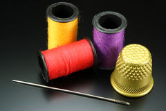Threads with needle and thimble Royalty Free Stock Image