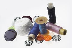 Threads and needles. Simple subjects on white background royalty free stock photography