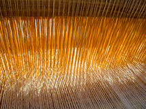 Threads in the old weaving loom Stock Photography