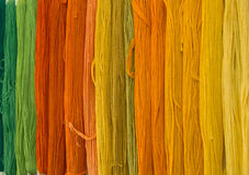 Threads rainbow. Colored threads for stitching, knitting, hand sewing Stock Photo